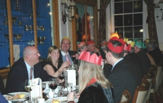 Guests enjoy good food, good company, Christmas crackers and paper hats