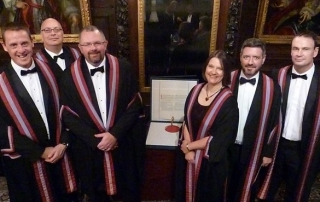 The six new Liverymen with the Companys new Royal Charter