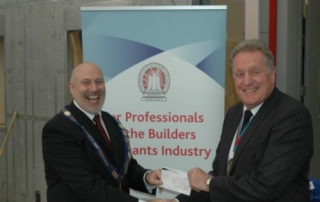 The then Master presents a cheque to the President of the IoBM Andrew Pine large